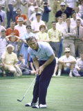 Golfer Arnold Palmer Lining Up Putt as Spectators Look on at Event Premium Photographic Print by John Dominis