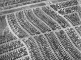 Aerial View of Acres of New Homes, Creating Compact Rows in Suburban Area Called Westchester Fototryk i høj kvalitet af Loomis Dean