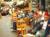 Lebanese Gentlemen sits at a steetside cafe sipping tea and smoking traditional narghile pipes Premium Photographic Print by Carlo Bavagnoli