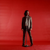 Rock Star Jim Morrison of the Doors Standing Behind Microphone Alone Against a Red Backdrop Premium Photographic Print by Yale Joel