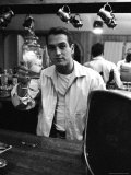 Actor Paul Newman Raising a Glass During an Informal Party Premium Photographic Print by Leonard Mccombe