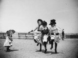 Sweetly Dressed Girls Jumping Rope Together, as Nearby Toddler with Parasol Looks On, at Ft. Greene Premium Photographic Print by Wallace G. Levison