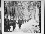 American soldiers on their tay to cut Off St. Vith Houffalize Road in Belgium, During WWII Premium Photographic Print by Richard A. Massenge