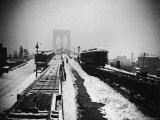 Snow Covered Train Tracks, Rooftops and Arches of the Brooklyn Bridge Seen from the Rear of a Train Premium Photographic Print by Wallace G. Levison