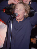 Actress Kathleen Turner Singing with Her Husband's Band Named the Suits at the Harley Davidson Cafe Premium Photographic Print by Eugene Gal