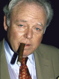 Actor Carroll O'Connor, Smoking Cigar Premium Photographic Print by David Mcgough
