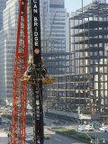Workers Service Crane Across Street from National Bank Building under Construction on Park Ave Reproduction photographique par Dmitri Kessel