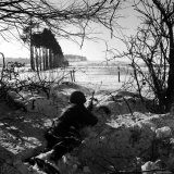 American Soldier Peering Across Snowy Field During Counter Offensive Known as Battle of the Bulge Photographic Print by John Florea