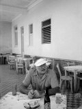 Author Ernest Hemingway in a Local Cafe Premium Photographic Print by Alfred Eisenstaedt