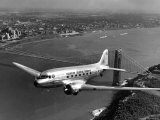 Canadian Colonial Airways Passenger Plane Flys over George Washington Bridge in Montreal, Canada Premium Photographic Print by Margaret Bourke-White
