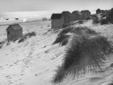 Cabanas Sitting on Sand Dunes with Clumps of Sea Grass Next to Rowboats Photographic Print by Eliot Elisofon
