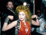 Singer Cyndi Lauper Flexing Her Muscles Premium Photographic Print by Ann Clifford