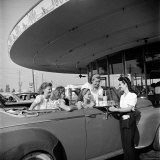 Women and Girls, in Convertible at Drive In, Greet Female Car Hop, Who Just Brought Their Drinks Photographic Print by Nina Leen