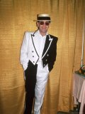 Singer and Songwriter Elton John in Black and White Tuxedo, Wearing Sunglasses Premium Photographic Print by David Mcgough