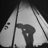 Woman Part of Group Riding Horseback Through Canadian Rockies Settling Into Tent for the Night Photographic Print by Wallace Kirkland