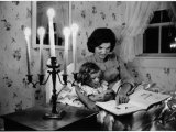 Wife of Senator Jackie Kennedy Reading Book to Her Daughter Caroline In Family's summer home Premium Photographic Print by Alfred Eisenstaedt