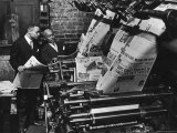 Newspaper Founder Robert S. Abbott Checking Printing Press at the African American Newspaper Photographie par Gordon Coster