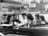 Teenage Girls Enjoying Milkshakes at Drive in Restaurant Premium Photographic Print by Nina Leen