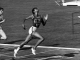 Wilma Rudolph, Across the Finish Line to Win One of Her 3 Gold Medals at the 1960 Summer Olympics Premium Photographic Print by Mark Kauffman