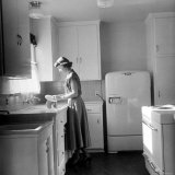 Housewife and Mother Barbara Barkin, Washing Dishes in Her Bright New Kitchen in Built Mobile Home Photographic Print by Ed Clark