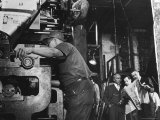 Man Working Newspaper Printing Press at Chicago Defender While Founder Robert S Abbott Checks Copy Premium Photographic Print by Gordon Coster