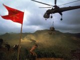 1st Air Cavalry Skycrane Helicopter Delivering Ammunition and Supplies to US Marines Photographic Print by Larry Burrows
