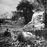 Buddhist Temple Destroyed During Karen Uprising, Buddha&#39;s Head Lying Where It Fell During Battle Photographic Print by Jack Birns