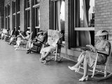 Elderly Ladies Reading Books and Newspapers While Rocking in Chairs on the Terrace of Dennis Hotel Premium Photographic Print by Alfred Eisenstaedt