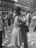 Man Kissing Girl in the Midst of Confetti Strewn Street Near the Latin Quarter Nightclub Photographic Print by Alfred Eisenstaedt