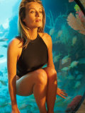 Model Frederique Van Der Wal Wearing Black Bathing Suit with Aquarium in Background Premium Photographic Print by Gene Gale