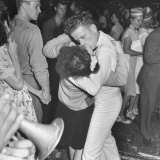 Sailor Kissing Pretty Girl amidst Jubilant Crowd in Celebration Regarding the End of WWII Photographic Print by Gordon Coster