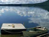 Rowboat Moored at Edge of Lake Showing Reflections of Clouds in Its Still Waters, in New England Photographic Print by Dmitri Kessel