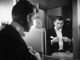 Composer/Conductor Leonard Bernstein Looking in Mirror before conducting Concert at Carnegie Hall Premium Photographic Print by Alfred Eisenstaedt