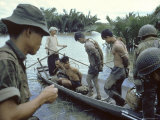 Nationalist S Vietnamese Soldiers Loading Viet Cong Prisoners Onto Canoe Like Boats in Mekong Delta Premium Photographic Print by Larry Burrows