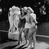 Jean Colleran, Peggy Lloyd and Betty Jane Hess Imitate Statue at Publisher William Randolph Hearst Photographic Print by John Florea