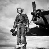 Margaret Bourke-White in Flight Suit, Holding Aerial Camera in Front of Flying Fortress Bomber Premium Photographic Print by Margaret Bourke-White