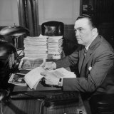 Director of the FBI J. Edgar Hoover Sitting at His Desk in His Office Premium Photographic Print by Thomas D. Mcavoy
