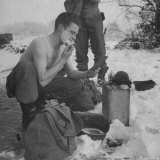 GI shaving with mirror during ull in the Ardennes Forest Conflict called the Battle of the Bulge Photographic Print by John Florea
