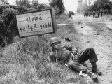 American Soldier Elmer Habbs of Delaware Resting as Troops Advance in Allied Invasion of Normandy Premium Photographic Print by Bob Landry