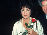 Actress Elizabeth Taylor Holding a Rose, with Broadway Producer Zev Bufman Premium Photographic Print by David Mcgough