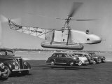 Igor Sikorsky Taking Off in Helicopter from Parking Lot Premium Photographic Print by Dmitri Kessel