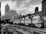 New York Central Passenger Train with a Streamlined Locomotive Leaving Chicago Station Photographie par Andreas Feininger