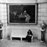 Men Sitting on Bench Below Painting by Hungarian Artist Mihaly Munkacsy in New York Public Library Photographic Print by Alfred Eisenstaedt