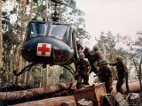 "American 4th Battalion, 173rd Airborne Brigade Soldiers Loading Wounded Onto a ""Huey"" Helicopter Photographic Print by Alfred Batungbacal"