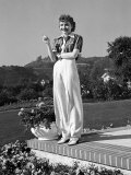Actress Claudette Colbert Holding Cigarette as She Suns Herself on Terrace of Her Holmby Hills Home Premium Photographic Print by Alfred Eisenstaedt