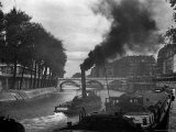 River Boat Smoke Passes along the River Seine Premium Photographic Print by Andreas Feininger