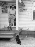 Boxer Joe Walcott Standing Outside Doorway of Building at Training Camp Premium Photographic Print by Tony Linck