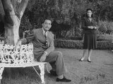 Surrealist Artist Salvador Dali with His Wife Gala in a Garden Premium Photographic Print by Martha Holmes