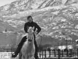 Actor Robert Redford Exercising One of His Eight Saddle Horses on His Remote Mountain Ranch Premium Photographic Print by John Dominis