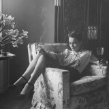Actress Olivia de Havilland with Cigarette and Glass of Beer in While Relaxing at Home Reproduction photographique sur papier de qualité par Bob Landry